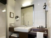 The spacious bathrooms have a modern and warm design with high quality towels and Rituals shower amenities. The Executive Room & Junior Suite bathrooms give you the extra bit of comfort of a bathtub as well as a separate showe and thick bathrobes.